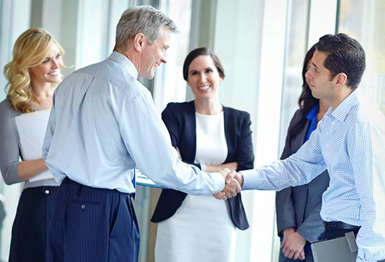 Business Owner Shaking New Employee's Hand